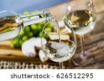 pouring white wine into the... | Shutterstock . vector #626512295