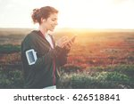 woman athlete using mobile... | Shutterstock . vector #626518841