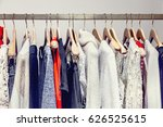 a row of clothes hanging on the ... | Shutterstock . vector #626525615