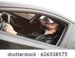 drunk driver driving a car.... | Shutterstock . vector #626538575