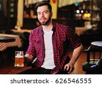 a pub visitor drinks beer from... | Shutterstock . vector #626546555