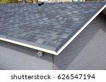 bitumen shingles roof.  | Shutterstock . vector #626547194
