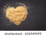 heart with brown sugar on black ... | Shutterstock . vector #626549495