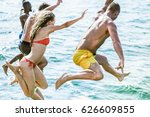 young friends diving in sea... | Shutterstock . vector #626609855