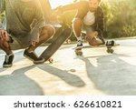 Small photo of Young skaters performing with skateboard at sunset in urban city park - Trendy people having fun with longboards - Extreme sport concept - Focus on left man left feet - Warm retro filter
