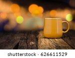 yellow ceramic empty mug on old ... | Shutterstock . vector #626611529