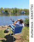 Small photo of ALGONQUIN, IL USE - APRIl 23: Fisherman waiting for a bite at Fox River in Algonquin, IL on April 23, 2017.