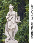 Small photo of Sandstone statue in the Saxon Garden, Warsaw, Poland. Allegorical depiction of History. Made before 1745 by anonymous Warsaw sculptor under the direction of Johann Georg Plersch