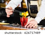 bartender is holding orange... | Shutterstock . vector #626717489