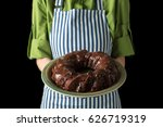 Chef In An Apron Holding A...