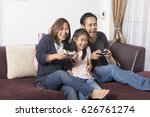 playful family playing video... | Shutterstock . vector #626761274