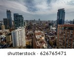 a busy city with tall towers... | Shutterstock . vector #626765471