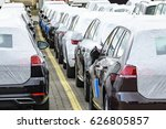 Factory-new cars still with protective foil are ready to the delivery - stock photo