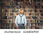 little pupil in library | Shutterstock . vector #626806904