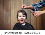 a little boy is trimmed in the... | Shutterstock . vector #626834171