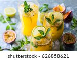 Small photo of Passion fruit lemonade garnished with lime and mint