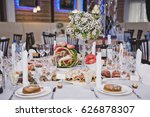 a round table with snacks and... | Shutterstock . vector #626878307
