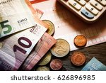 euro banknotes and coins with... | Shutterstock . vector #626896985