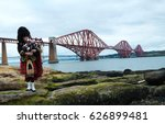 Scottish Piper Playing Beside...