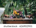 a wooden table among tropical... | Shutterstock . vector #626902901