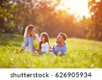 child on picnic with parents... | Shutterstock . vector #626905934