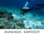 scuba diver swim through coral... | Shutterstock . vector #626910119