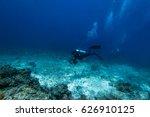scuba diver swim through coral... | Shutterstock . vector #626910125
