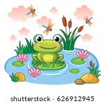 The Frog Sits On A Leaf In The...