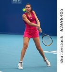 Small photo of BEIJING-OCT 7:Gisela Dulko of Argentina and Flavia Pennetta (pictured) of Italy play against N.Llagostera Vives and M.J.Martinez Sanchez of Spain at the 2010 China Open on Oct 7, 2010 in Beijing,China