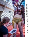 Small photo of Scarborough, UK - April 08, 2017: Female being body painted to look like an 'Alien' from the 'Alien' film series at Sci-Fi Scarborough.