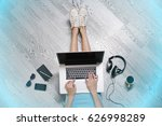 young woman sitting on floor... | Shutterstock . vector #626998289