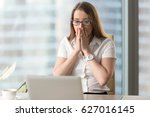 Small photo of Surprised businesswoman looking at laptop screen. Pretty girl suddenly puzzled with e-mail or news in Internet. Young female office worker looks shocked after computers critical failure