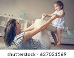 young mother playing with her... | Shutterstock . vector #627021569