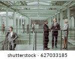 Small photo of Business partners negotiating conract, talking in office building