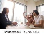 young woman wearing virtual... | Shutterstock . vector #627037211