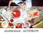 top view of boy making pizza... | Shutterstock . vector #627058199
