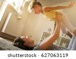 mother with her daughter... | Shutterstock . vector #627063119