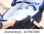 hand of woman pushing babies...   Shutterstock . vector #627067385