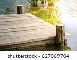Wooden Dock With Sunlight On...