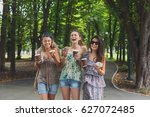 happy girls have fun and eat... | Shutterstock . vector #627072485