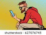 the hipster looks at smartphone.... | Shutterstock .eps vector #627076745