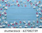 frame of white flowers of... | Shutterstock . vector #627082739