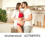pregnant woman with husband in... | Shutterstock . vector #627089591
