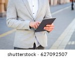 business man use tablet on... | Shutterstock . vector #627092507