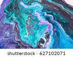 Small photo of Abstract artistic photograph of a staged action painting scene. Liquid Colors ink drops paint depth. Colorful blend of water colors on white background.