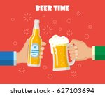 hands holding beer glass and... | Shutterstock . vector #627103694
