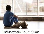 Sad Little Boy Sitting On Floo...