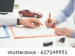 woman signing a car insurance... | Shutterstock . vector #627149951