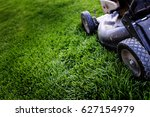old lawn mower on lush green... | Shutterstock . vector #627154979