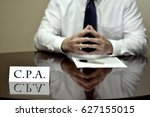businessman cpa at desk with... | Shutterstock . vector #627155015